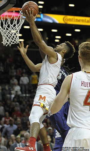 Melo Trimble adjusting in mid-air to sink the game-winning layup against Kansas State with 6.6 seconds remaining in the game.
